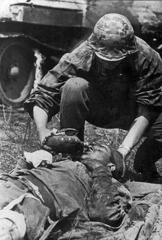 """mavitpzv: """" COMPASSION. A soldier Waffen SS gives a Soviet infantryman seriously injured a sip of water. Russia in 1943. """""""