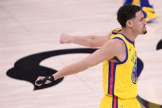 Golden State Warriors' Klay Thompson (11) stretches before playing the Sacramento Kings during NBA game at the Golden 1 Center in Sacramento, Calif., on Saturday, March 31, 2018. (Jose Carlos Fajardo/Bay Area News Group)