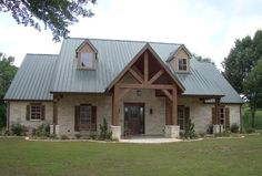 "Texas Hill Country home design: the tin roof, white limestone exterior and cedar beams highlight this home in East Texas. For more photos, visit ""Texas Hill Country Inspiration"" on Houzz by Trent Williams Construction Management. Hill Country Homes, Texas Hill Country, Country House Plans, Country Houses, Barn Style House Plans, Metal House Plans, Rustic House Plans, House In The Country, Poll Barn House"