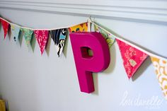 Next stop..Bunting for Mikeys room...made from his old favorite t-shirts maybe?