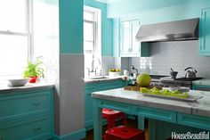 """""""I like kitchens to have a utilitarian clarity,"""" Miles Redd says. """"The pale robin's-egg blue and the white subway tile — it's just a fresh place to be in the morning."""""""