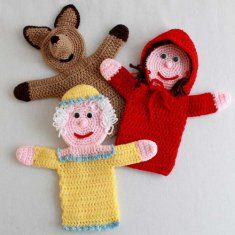 "PA860 Storybook Puppets: Red Riding Hood Crochet Pattern- Little Red Riding Hood with Basket, Wolf and Grandmother are now available in a hand puppet size. Little Red Riding Hood is sporting pig tails with a hooded cape and basket. Grandma has a Bonnet and Wolf a long snout and evil looking eyes. Each measures about 12"" or 15"" inches tall depending on yarn used. Skill level: Intermediate."