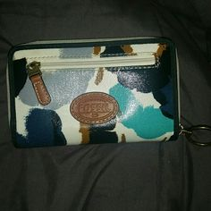 Super cute authentic Fossil wallet! Fossil wallet- white with black and blue prints. The only flaw is some paint has come off the zipper, other than that it's in perfect condition! Fossil Bags Wallets