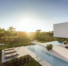 """Settled in Algarve, Portugal, this refreshing house was created by Visioarq Arquitectos. """"The QL House is inhabited in one of the most expensive areas of Algarve, on the Portuguese southern coast, a singular appearance in Architecture Antique, Architecture Design, Modern Architecture House, Swimming Pool Designs, Swimming Pools, Small Pool Design, Sweet Home, Modern Home Interior Design, Small Pools"""