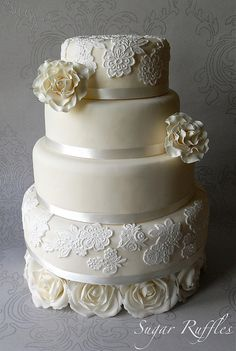 Lace and rose adorned wedding cake