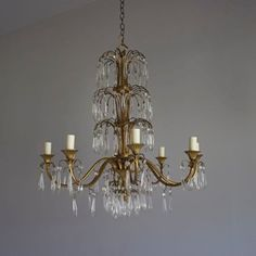 A really pretty French waterfall chandelier, brass frame decorated in cut glass icicles 8 arms, rewired and tested and sold with a suitable ceiling plate and a metre of chain and flex.   Width: 70cm (27.