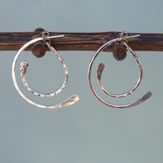 """New Arrival! Our unique hammered sterling hoop earrings add fun to your everyday wear or a night out with the girls.These quality post earrings feature a front and back hoop with a playful swinging motion.Handcrafted with .925 silver, 1 3/4"""" long.     .925 sterling silver   Handcrafted   Flat rate USPS w/tracking shipping to anywhere in the USA for $5.95   Unique front back design"""