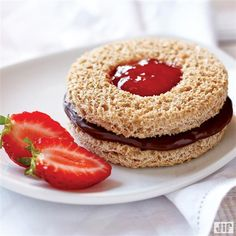 Make this fun sandwich for their lunchbox! Use wheat bread, Jif® Chocolate Flavored Hazelnut Spread, Smucker's® Strawberry Preserves and Smucker's® Natural Strawberry Fruit Spread to make this Chocolate Hazelnut Peek-A-Boo Sandwich.