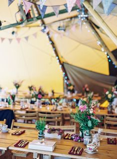 Rustic Teepee Wedding with lots of florals & bunting -    Image by Ann-Kathrin Koch Photography - Lace Lusan Mandongus and Belle & Bunty bridal gowns for a welsh speaking rustic wedding in Snowdonia Wales by Ann-Kathrin Koch photography