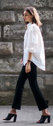 db989c52be8 Oversize long sleeve collared Crisp white shirt over narrow black pants  with high mules