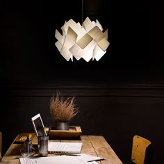 The domino effect in lighting, a chain of self supporting squares falling into a ring of light. This ESCAPE S pendant lamp by Irish designer Ray Power for LZF creates a domino circle caught in a const Light Luz, Light Rays, Wood Pendant Light, Pendant Lighting, Pendant Lamps, Modern Lighting, Lighting Design, Funky Lighting, Lighting Ideas