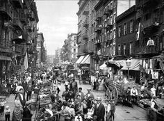 """In the early 1900s, New York became overcrowded, due to the massive population of immigrants. To solve this problem, NYC created tenements- """"dark, poorly sanitized living quarters for the lower classes"""". These poor excuses for apartments soon became a breeding ground for disease, poverty, and prostitution. This picture shows the streets of New York during this period of time."""