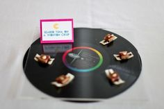 "Serve appetizers on 80s records with food labels as the ""song"".love a good 80s theme party!"