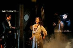 More silly Phantom of the Opera captions. I like this shot; Raoul outside the door, Christine in her room and the Phantom through the mirror.