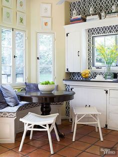 At the end of this kitchen, a tiny banquette and a few chairs are tucked under the window. This sliver of space allows dining for at least four people, which the kitchen lacked before this custom bench was added. Plus, the bench opens up to provide additional storage to the small space.