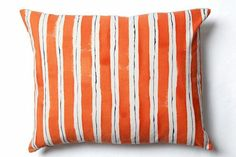 """Tip 5:  """"I have fallen head-over-heels for the hand-dyed pillows created by Rebecca Atwood. Each pillow is a work of art and can transform an ordinary sofa or chair into something extraordinary. I currently have three in my own home and they make me smile every time I look at them."""" Rebecca Atwood Painted Stripe Pillow, $225, available at Rebecca Atwood.  #refinery29 http://www.refinery29.com/interior-design-tips#slide-5"""