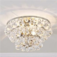 Robert Abbey's Bling semi-flush mount. These look great in bathrooms or halls. Very stylish and they give off a gorgeous light! They are available at many sources.