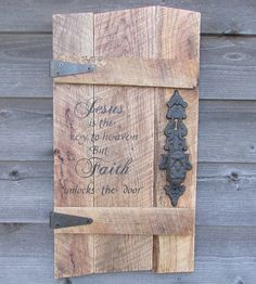 """This Primitive Rustic wood Sign is made of reclaimed pallet wood, it measures approximately 26"""" X 13"""" It is hand painted, and includes Ornate hinges and a rustic door knob. It has the scripture verse"""