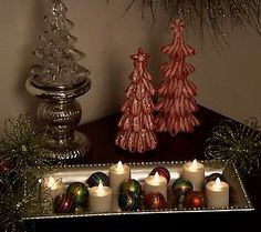 Luminara flameless votive candles!  These are amazing, so many decorative uses.  No batteries needed, they're rechargeable!