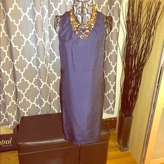 Silk Banana Republic Dress This Banana Republic silk dress is a shift like silhouette, has a crisscross back, and pockets. There is no lining attached but the silk does not allow you to see through. Banana Republic Dresses