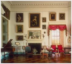 Parlor « Thomas Jefferson's Monticello. Its hard to tell in this shot, but the pictures hang from what looks like painted (black) conduit with a metal chain. love this idea for hanging pictures. Jefferson Monticello, Monticello, Interior Design, House, Home, Interior, Historic Homes, Wood Floor Pattern, Room