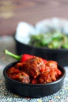 These spicy chorizo meatballs are served in a rich, authentic tomato and padron pepper sauce. Spanish tapa at it's best.