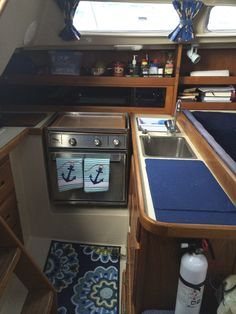 Galley on board a 1986 Catalina 30 sailboat. Find out more at...fillyoursails.org.