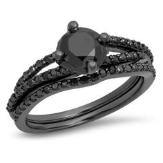 Ask for her hand and offer your heart with this stunning black rhodium plated sterling silver bridal set. The engagement ring shines with a center round black diamond solitaire shining brightly. additional smaller round black diamonds also grace the shank and the matching wedding band is lined in round Prong set black diamonds.