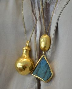 Pippa Small Jewellery - A pure gold perfume bottle worn to the heart to keep the scented oils warm and fragrant and an uncut labradorite pendant necklace #PureGoldJewellery
