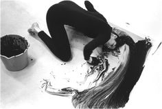 Loving Care,1992  Janine Antoni  Performance of her dipping her hair in hair dye and painting the gallery floor.