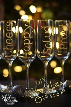 New Year's champagne glasses personalized with glass etching to toast in 6 different languages. Easy DIY for New Year's celebrating. #Champa...