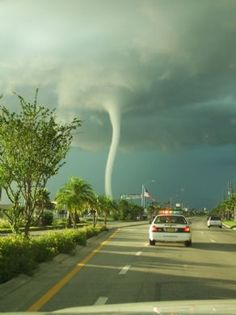 Beautiful white tornado! (looks like the cop is going after it, hehe)