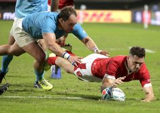 Wales' Tomos Williams scores a try during the Rugby World Cup Pool D game at Kumamoto Stadium between Wales and Uruguay in Kumamoto, Japan, Sunday, Oct. (AP Photo/Aaron Favila) Latest: Japan reaches first World Cup quarterfinal World Cup Games, First World Cup, Wales Rugby, Pool Games, Kumamoto, Threes Game, Rugby World Cup, Japan, Uruguay