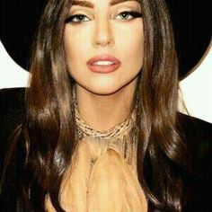 Lady Gaga with brown hair; her makeup looks so amazing!!!