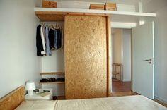 shelf above bedroom door for more storage space