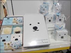 """Japanese packaging design at its best. When it is also at its simplest… three black dots and two black lines on a plain white box. And there you have the simple but distinct face of the """"Shirokuma"""", or white bear, that lives at the Maruyama Zoo in Hokkaido. His image used here to sell manju snack cakes…"""