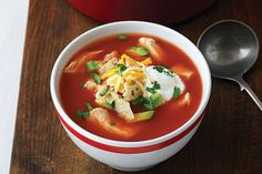 Want to make an awesome tortilla soup? Start with zesty chicken, add tomato sauce and top it all off it with cheese, avocado and cilantro.