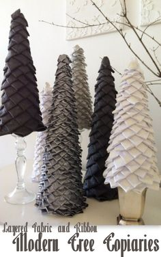 Christmas topiaries made from fabric and ribbons on a foam core