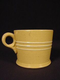 Here we have a very attractive mug dating to the These early yellow ware mugs are not often found in this fine condition and this would be prized by any yellow ware collector. Childrens Mugs, Yellow Bowls, White Mocha, Sugar Bowls And Creamers, Bean Pot, Stoneware Crocks, Large Baskets, Lemon Recipes, Tea Bowls