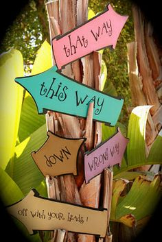love the signs on this tree-such a great way to continue the decor