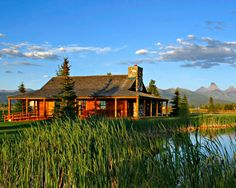 Absolute dream home! Log cabin in the middle of no where with mountains and water surrounding! Love!!!!