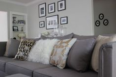 neutral living room/family room; grey couch neutral pillows