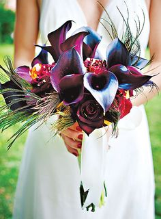 Brides: Calla Lily and Peacock Feather Bouquet . Bouquet of calla lilies, hocus-pocus roses, and peacock feathers, with amber gems
