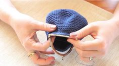 This simple tutorial by crochet pattern designer Stephanie Davies runs through how to attach a coin purse opener to a crocheted coin purse. The pattern for t...