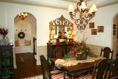 Dining room with arched doorway to front foyer space