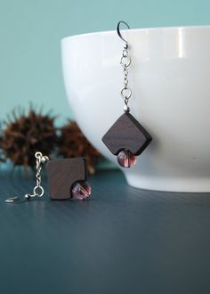 Les coins ronds  wooden earrings with purple beads by 3dots, $26.00