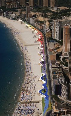 Benidorm, Spain - The town is divided into five parts, Poniente and Levante, each fronted by a beach of the same name, the old town (also called El Castell), La Cala situated to the west side of Poniente and El Rincón de Loix situated to the east side of Levante. Between the two beaches lies a rocky promontory and the port. Most of the hotels occupy sections inland from the two beaches. A few miles from shore is an uninhabited island.