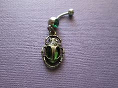 Ancient Egyptian scarab beetle belly button rings, body jewelry by sindys on Etsy https://www.etsy.com/listing/196627499/ancient-egyptian-scarab-beetle-belly