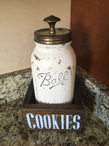What better way to store your cookies than this beautiful half gallon mason jar!!!  This is the newest addition to our shop and one of the cutest!  This package includes a half gallon distressed mason jar, one custom fitted planter box WITH a hand painted stencil and one plastic lid  Add a little more decoration with an installed knob for a small additional fee