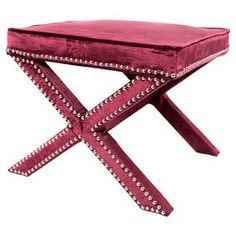 """Wrapped in sumptuous wine-hued velvet upholstery, this nailhead-trimmed ottoman adds a touch of glamour to your decor.    Product: OttomanConstruction Material: Wood and crushed velvetColor: Wine  Features:  Nailhead trim detailingHandmade in Singapore  Dimensions: 18"""" H x 21"""" W x 21"""" D"""